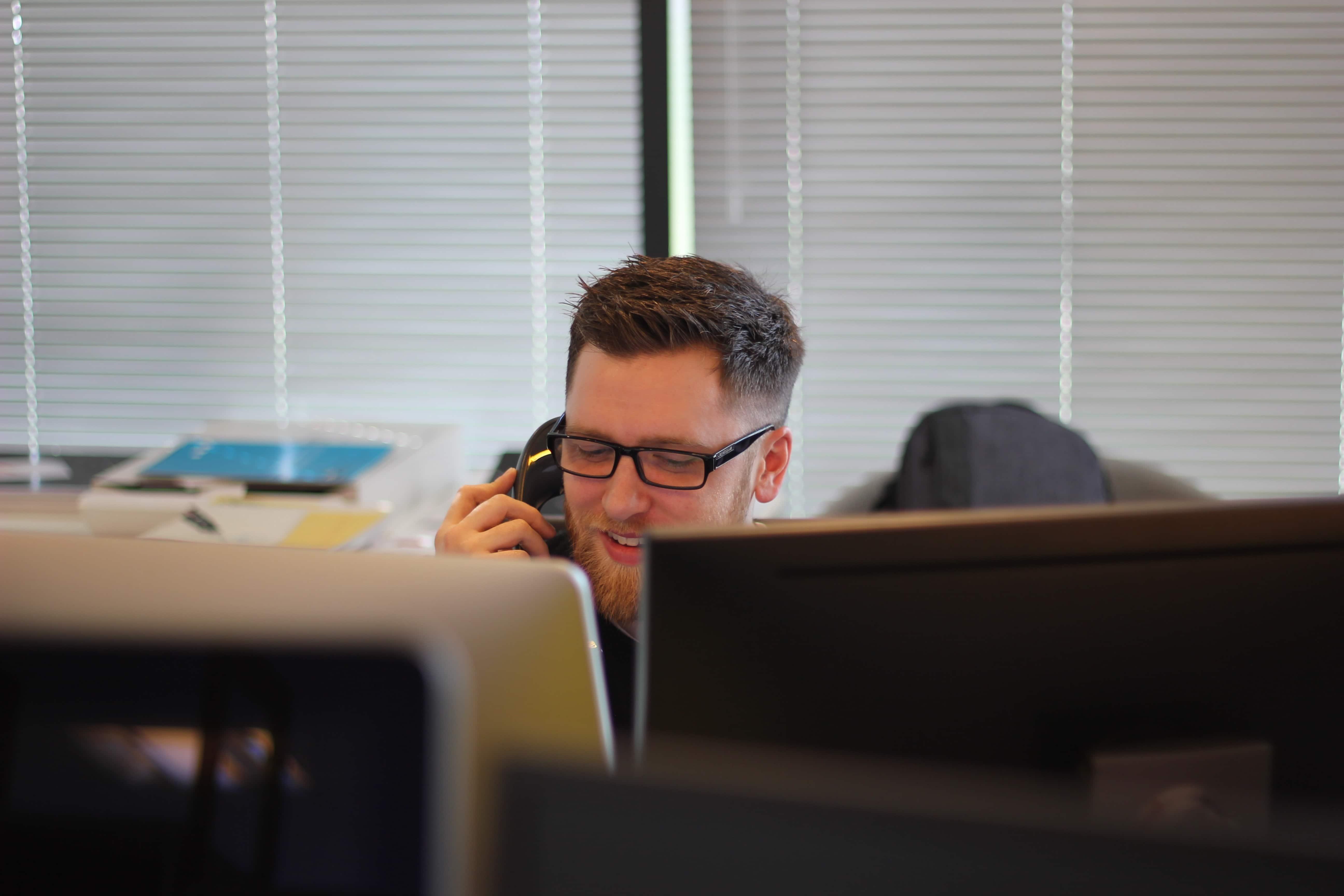 a customer service representative making a call